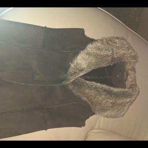 Brown suede and fur vest.